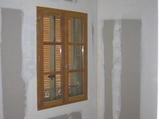 Pose de fenêtre double vitrage et volets menuiseries bois